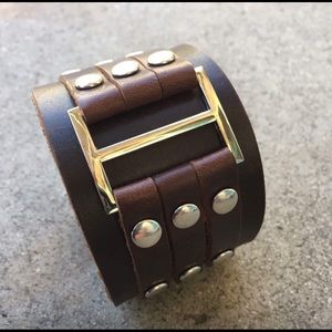 Other - Brown composite leather cuff with metal accents